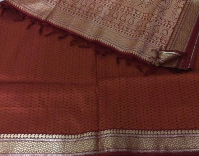 A Kanjivaram saree with a Jacquard weave in the body and zari on the border