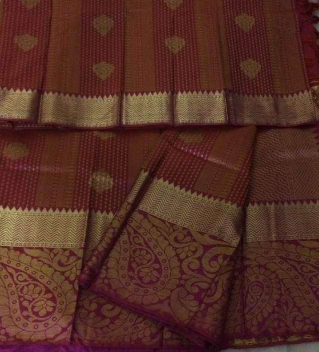 A Kanjivaram with intricately woven designs with Zari.